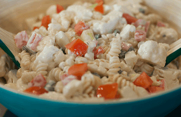 Refreshing cauliflower ranch summer salad recipe. Great for bbqs and potlucks. Learn how to make this delicious side salad.