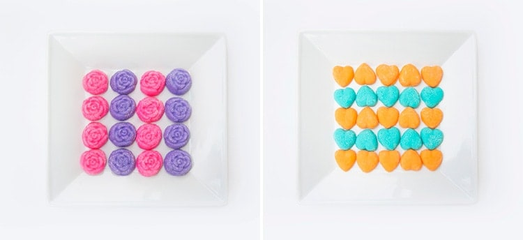 Finished cream cheese mints on plates in pink, purple, orange, and turquoise colors