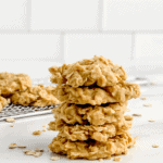 No Bake Peanut Butter Oatmeal Cookies Stacked with More Cookies on a Wire Rack